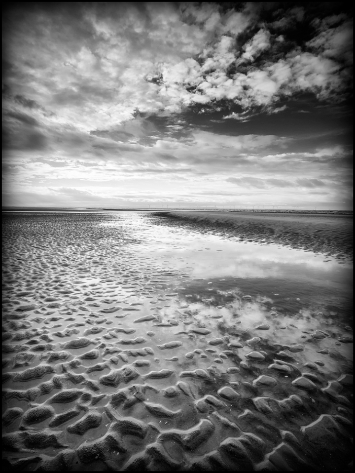 Formby captured on a GX1 with Olympus 9-18 lens at 9mm. The conversion to B&W was made using Nik Silver Efex Pro 2