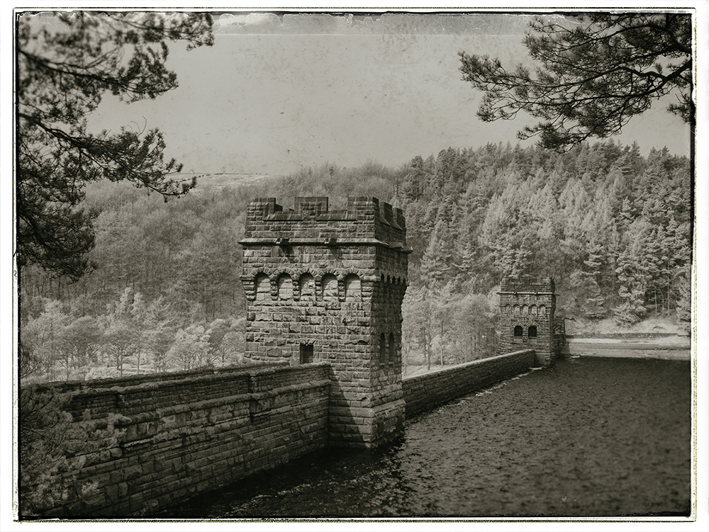 The dam at Ladybower. Captured on a Panasonic GX1 converted to shoot infrared then processed in Nik Silver Efex Pro and Nik Analog Efex.