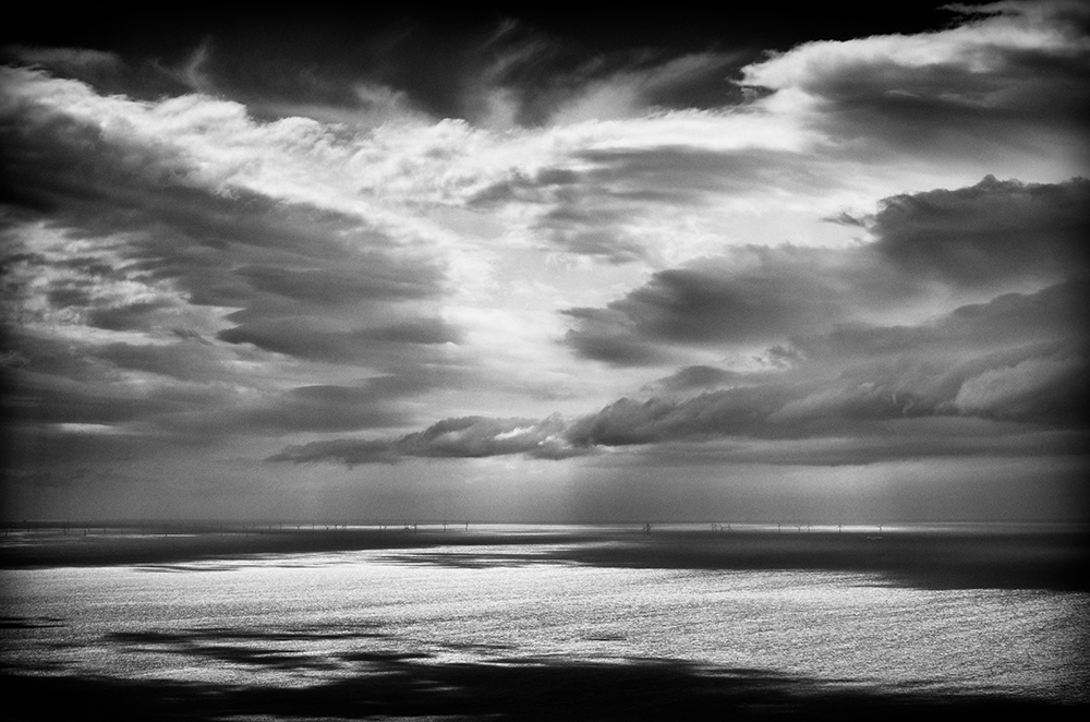 Sea and cloud scape. Shot with an Olympus EM5 and processed using Nik Silver Efex