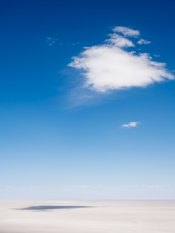 Cloud over the salt flats at uyuni, bolivia