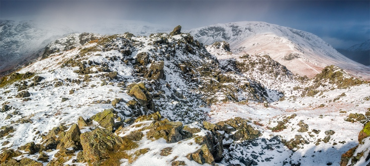 Three image stich of Helm Crag with approaching snow storm. Canon G16.