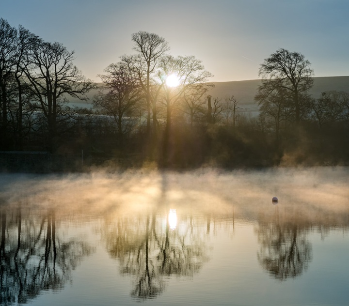 Early morning mist on Ullswater in the Lake District.