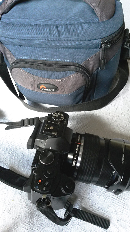 EM5 with 12-40 lens and small shoulder case.