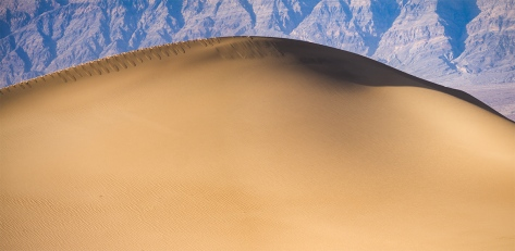 "Death Valley Sand Dune. Panasonix GX1 with 45-150mm lens. f/8.0, ISO 160, 1/200""."