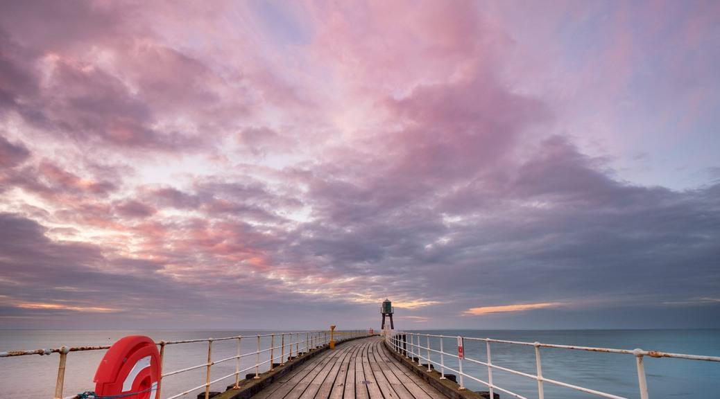 Whitby Pier at Sunset. v