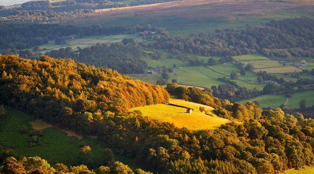Peak District hills at sunset.