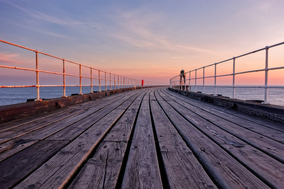 """Whitby Pier at sunrise, Sony RX100, ISO80, f/5.0, 1/30""""."""