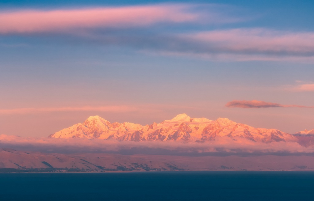 The Andes at sunset from Isle de Sol on Lake Titicaca, Bolivia.